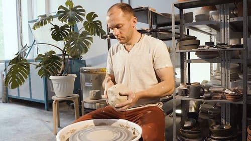 Video Of Man Molds A Clay Pot