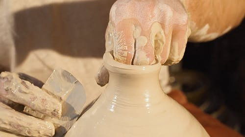 Video Of Man Molds The Tip Of A Clay Pot