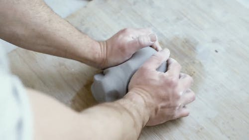 Video Of Person Mashing Clay