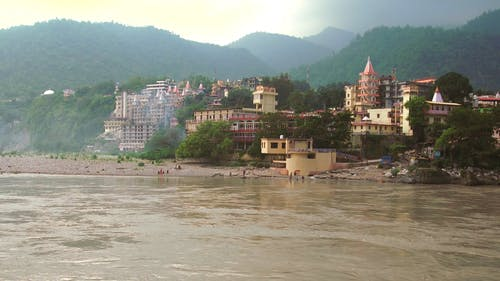 View Of Buildings Standing Near A River