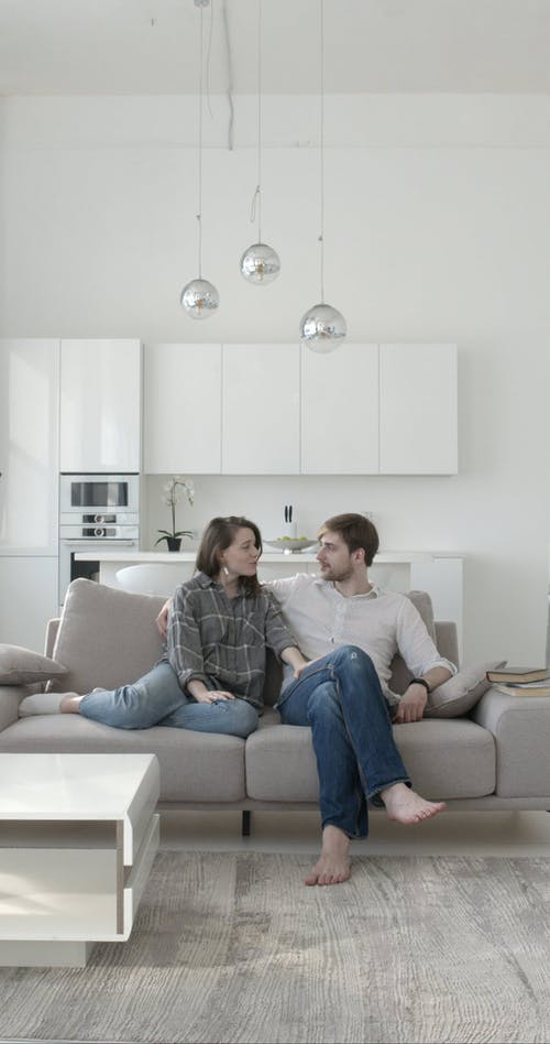 Couple Sweet Moments Together While Sitting on Sofa