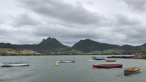 Boats Docked On Sea Under A Gloomy Sky
