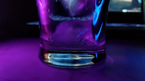 Pouring Drink in a Glass with Ice