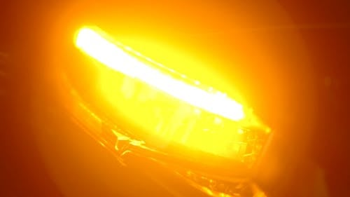 Close-Up Video Of Headlight Turning On