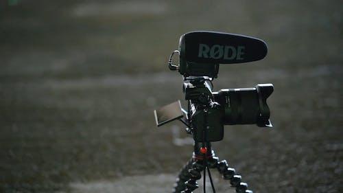 Black Modern Camera On A Tripod