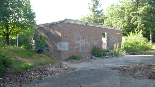 Exterior Of A Demolished Building With Graffitti On Brickwalls