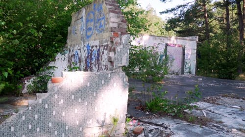 A Demolished Building With Graffitti On Walls