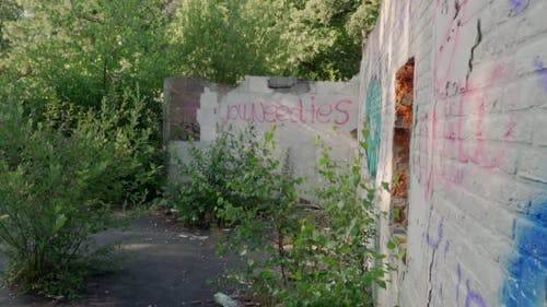 A Demolished Building With Graffiti On Walls