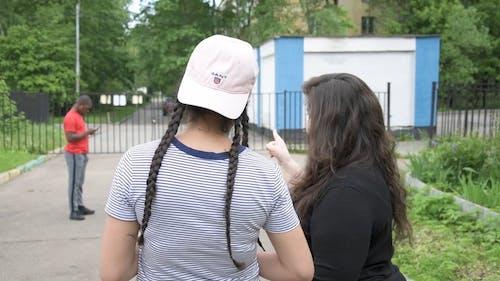 Two Women Talking about a Man