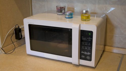 Video Of Person Heating Up A Bread On A Microwave