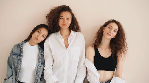 Portrait Of Three Multiracial Women Posing For Photoshoot