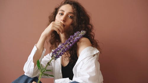 Woman Posing With A Lavender Flower