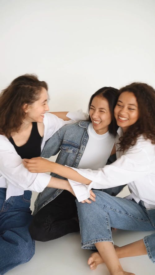 Three Women Hugging Each Other