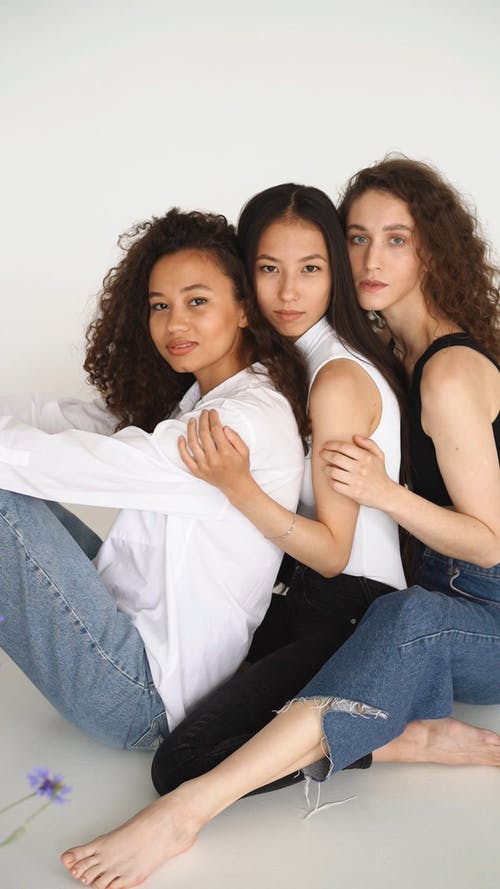 Three Women Posing Close To Each Other