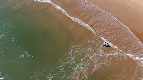 An Aerial Footage of a Couple on the Beach