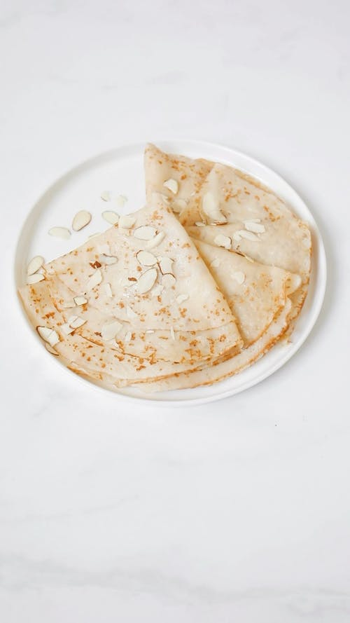 Close-Up Video Of Sliced Almonds Sprinkled To The Crepes