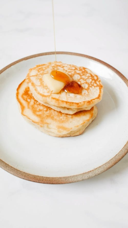 Video Of Pancakes With Sprinkled Maple Syrup