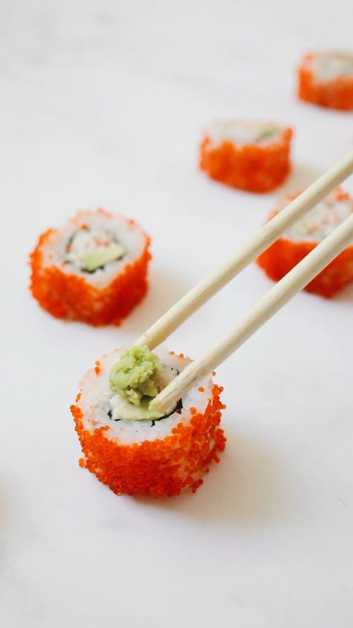 Close-Up Video Of Person Putting Wasabi On Sushi