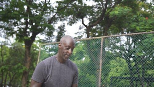 Man Shooting the Basketball