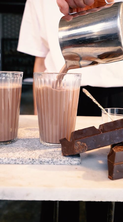 A Person Making Chocolate Drinks