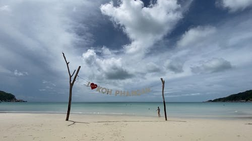 White Sand Beach Resort Under A Cloudy Sky