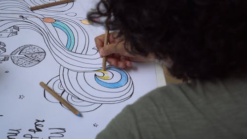 Crop Man Coloring A Drawing On A Whiteboard