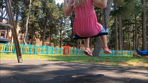 Video Of Girl Using The Swing In Playground