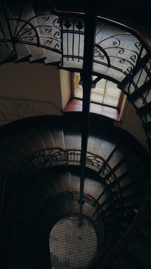 A Couple Going Up The Spiral Staircase