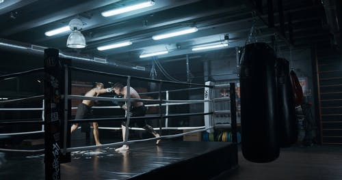 Two Men Sparring In Kick Boxing