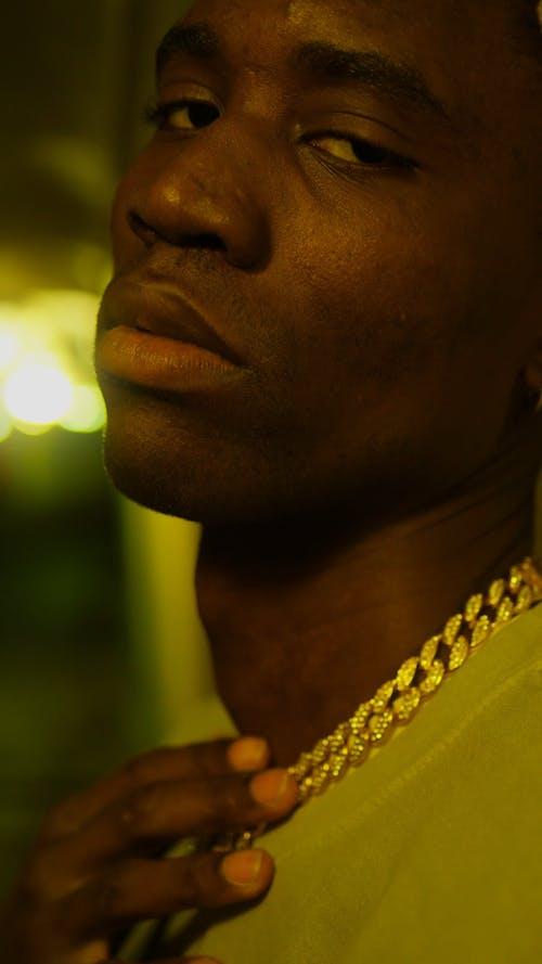 A Man Wearing A Gold Chain