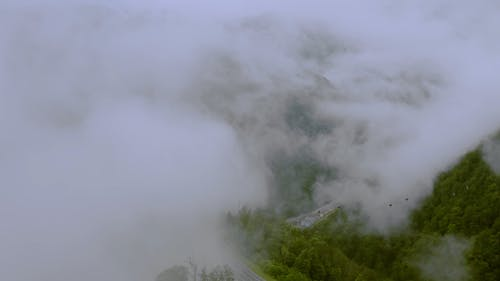 Drone Footage Of Mountains On A Foggy Day
