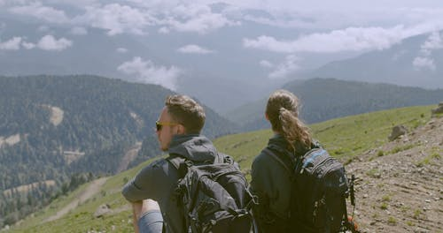 A Couple Enjoying The View From A Mountain Top