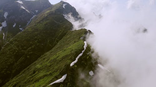 Drone Flying Over The Mountain Peak