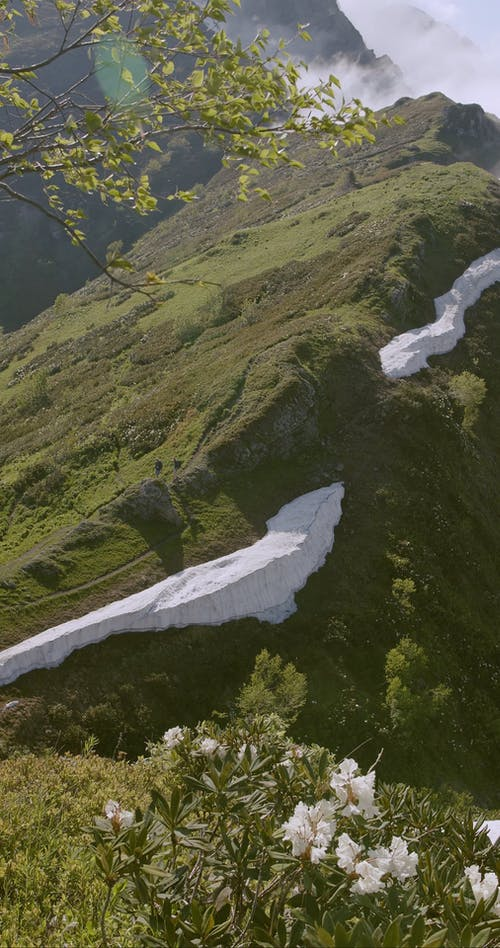 High Angle Footage Of A Mountain Peak With Snow Residue
