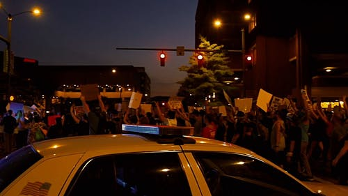 People Marching And Protesting On The Street