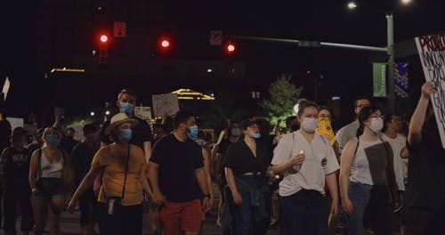 People Marching On The Street In Protest