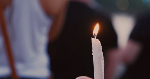 Person Holding a Lighted Candle