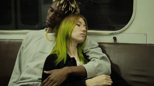 A Couple Riding The Subway