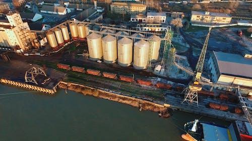 Cargo Ships Docked At A River Cargo Harbor