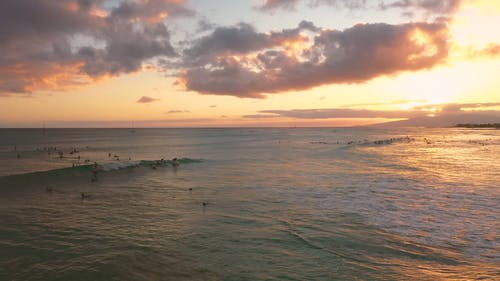 Surfing The Waves Of The Beach In Hawaii