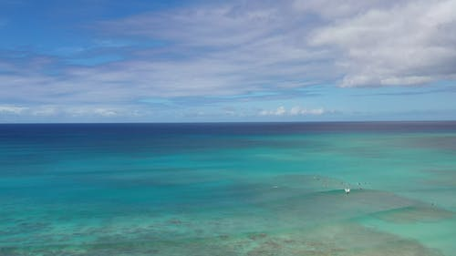 Aerial View of Seascape Under White Clouds