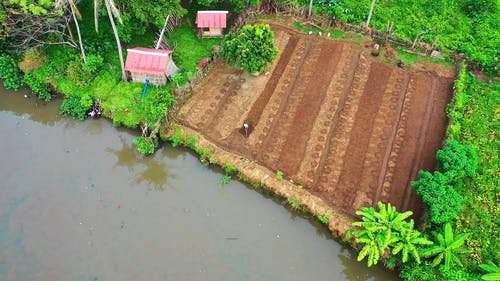 Aerial View of Person Tilling His Farmland