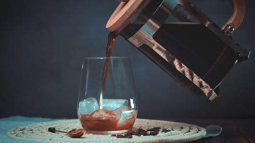 Black Coffee Poured in Drinking Glass