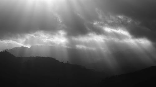 Sun Rays Over The Mountain In A Black And White Video