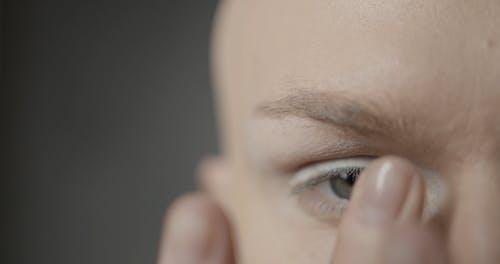 Close-Up View of Man Applying Eyeshadow
