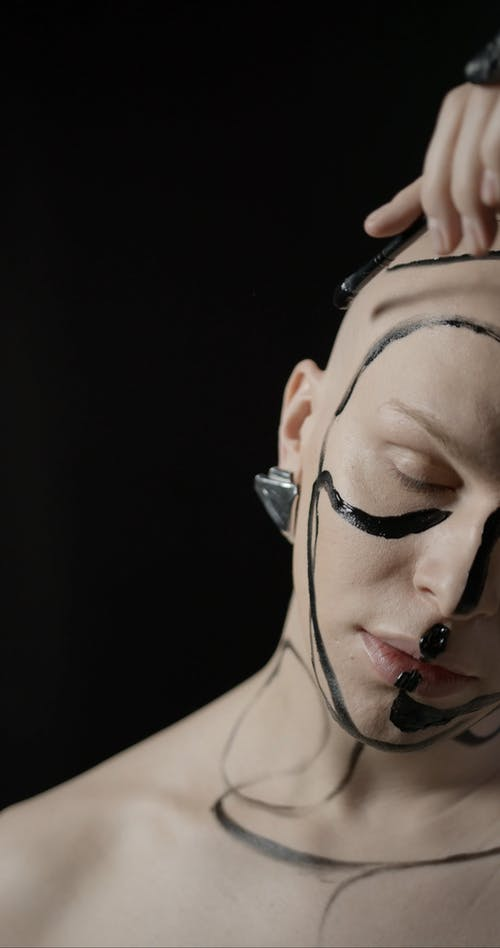 Painting One's Face With Black