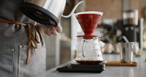 Pouring Hot Water To Make A Brewed Coffee