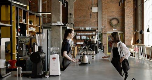 A Customer Getting Her Brewed Coffee