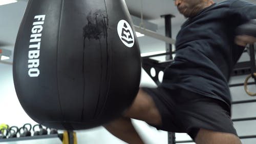 Striking a Heavy Bag With A Knee