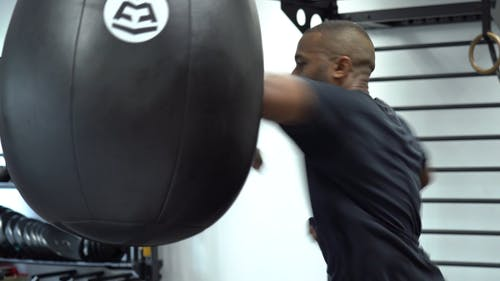 Repeated Hitting A Heavy Bag With Elbows
